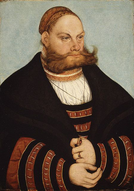 Portrait of a man with a gold-embroidered cap.jpg